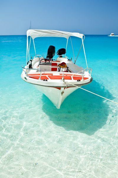 boat anchored on a snadbar