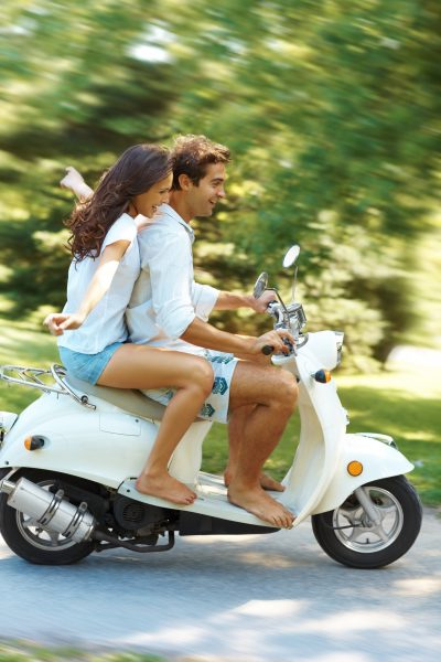 couple riding a scooter